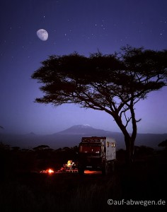 The quintessential camping photo, resembling beauty, freedom, romance, and peace. It is taken by my photographer friend Michael Boyny on their 1.5 year camper trip in Africa with Mathilda as he and his wife Sabine called their truck. That's Kilimajaro in the background.