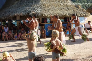 Sailors' children watching a local Polynesian dance