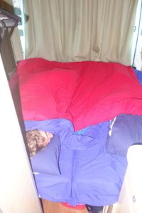 The settee turned bed in the camper we rented for three - cold - weeks in New Zealand