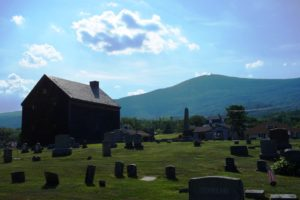 Mount Greylock behind a cemetery in the town of Adams